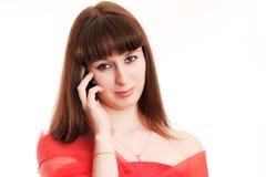 La muchacha habla por el teléfono Imagen de archivo libre de regalías