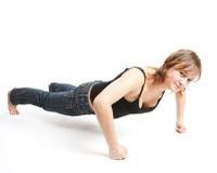 La muchacha hace ejercicios de los deportes Imagenes de archivo