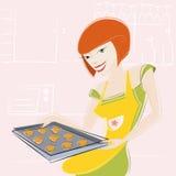 La muchacha hace una torta Imágenes de archivo libres de regalías