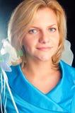 La muchacha-hada en una alineada azul Fotografía de archivo libre de regalías