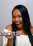 La muchacha haitiana hermosa sostiene 2012 Imagenes de archivo
