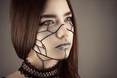 La muchacha hermosa compone en estilo del Cyberpunk fotografía de archivo