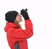 La muchacha hermosa con el binocular Foto de archivo