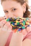 La muchacha hermosa con el confeti aislado Imagenes de archivo