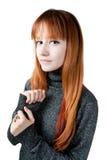 La muchacha hermosa con el pelo largo rojo en un suéter Fotografía de archivo libre de regalías