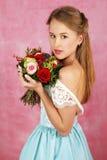 La muchacha hermosa con las flores Imágenes de archivo libres de regalías