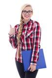 La muchacha hermosa en lentes con el libro en su mano manosea con los dedos encima de la ISO Fotos de archivo libres de regalías