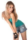 La muchacha hermosa en los cortocircuitos aislados Imagen de archivo libre de regalías