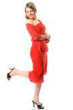 La muchacha hermosa en una alineada roja Imagenes de archivo