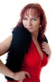 La muchacha hermosa en una alineada roja Fotografía de archivo
