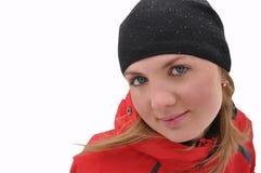 La muchacha hermosa en una chaqueta roja Foto de archivo