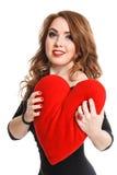 La muchacha hermosa en vestido negro con rojo oye en un fondo blanco Imagen de archivo libre de regalías