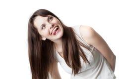 La muchacha hermosa está sonriendo Foto de archivo libre de regalías