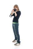 La muchacha hermosa joven con la cámara aislada Fotografía de archivo libre de regalías