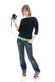 La muchacha hermosa joven con la cámara aislada Imagen de archivo libre de regalías
