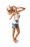 La muchacha hermosa joven con los auriculares Fotografía de archivo libre de regalías