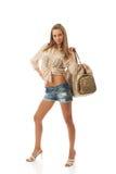 La muchacha hermosa joven con un bolso Imagen de archivo libre de regalías