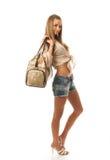 La muchacha hermosa joven con un bolso Fotos de archivo libres de regalías