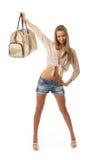 La muchacha hermosa joven con un bolso Imagenes de archivo