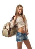 La muchacha hermosa joven con un bolso Imagen de archivo