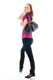 La muchacha hermosa joven con un bolso aislado Fotografía de archivo