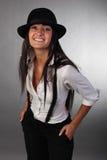 La muchacha hermosa joven en un sombrero Fotografía de archivo libre de regalías