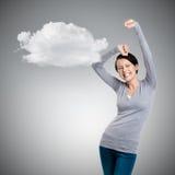 La muchacha hermosa que gesticula los puños triunfales es feliz Imagen de archivo libre de regalías