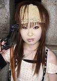 La muchacha japonesa presenta en el equipo de Cosplay en Tokio Imagen de archivo libre de regalías