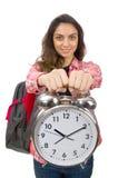 La muchacha joven del estudiante con el despertador Imagenes de archivo