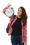 La muchacha joven del estudiante con el despertador Fotografía de archivo