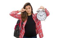 La muchacha joven del estudiante con el despertador Fotos de archivo libres de regalías