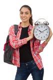 La muchacha joven del estudiante con el despertador Imagen de archivo
