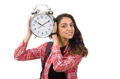 La muchacha joven del estudiante con el despertador Imágenes de archivo libres de regalías