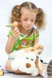 La muchacha juega al doctor Imagen de archivo libre de regalías