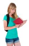 La muchacha lee el libro Fotos de archivo
