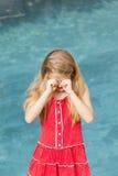 La muchacha limpia ojos Imágenes de archivo libres de regalías