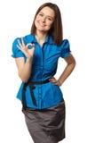 La muchacha linda en la camisa azul muestra muy bien Imagen de archivo