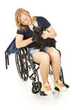 La muchacha lisiada conforta el perro Fotos de archivo libres de regalías