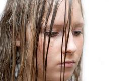 La muchacha llora Foto de archivo