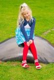 La muchacha miente bola Fotografía de archivo libre de regalías