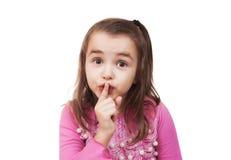 La muchacha muestra la muestra del silencio Imagenes de archivo