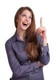 La muchacha muestra un dedo para arriba en algo Fotografía de archivo