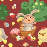 La muchacha o el muchacho inconsútil del modelo que caza el huevo de chocolate decorativo, bebé feliz se sienta en una cesta, tra Imagen de archivo libre de regalías