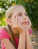 La muchacha piensa Fotos de archivo