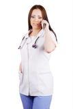 La muchacha que el doctor habla por el teléfono Foto de archivo