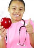 Una manzana al día mantiene al doctor ausente Imagenes de archivo