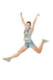 La muchacha que salta para la alegría Imágenes de archivo libres de regalías