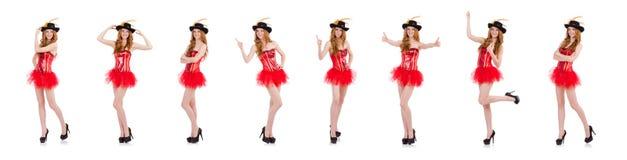La muchacha roja del pelo en el traje del carnaval aislado en blanco foto de archivo