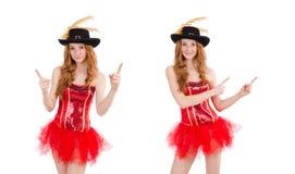 La muchacha roja del pelo en el traje del carnaval aislado en blanco imagen de archivo