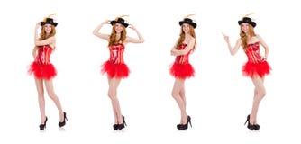 La muchacha roja del pelo en el traje del carnaval aislado en blanco imagen de archivo libre de regalías